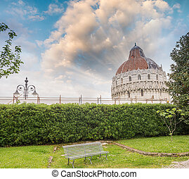 Pisa. Baptistery in Square of Miracles as seen from a nearby gar