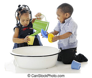 Bucket of Fun - A young brother and sister having fun...