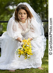Jilted Bride - A pretty young summer bride distressed on her...