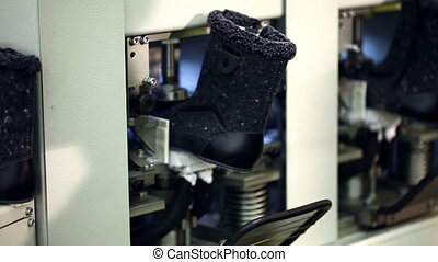View of fixed boots on automatic machine, close-up