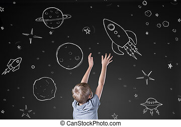 Rocket in drawn space - Little boy reaching for rocket in...