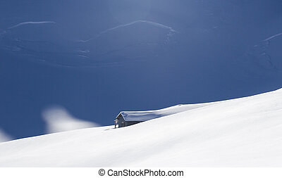 Lonely hunting snowbound lodge in Alps, Italy