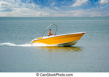 Yellow speed-boat - The yellow speed-boat  floating on a sea