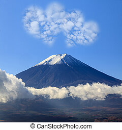 the sacred mountain of Fuji in the background of blue sky at...