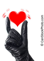 Shaken heart concept with a hand wearing black glove trying...