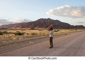 Sossusvlei park, Namibia - Potographer at the Sunrise in the...