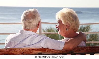 Senior couple on vacation - Senior couple enjoying sea view...