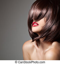Beauty model with perfect long glossy brown hair Close-up...