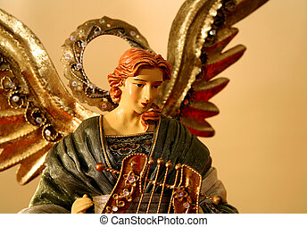 Warm lighted angel from the top of a Christmas tree in...