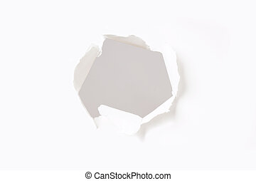 hole in paper wall - gaping hole with torn ragged edges in...