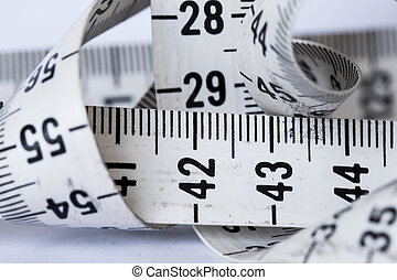 Measuring Tape - A measuring tape on a white background
