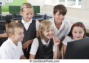 Group Of Elementary School Pupils In Computer Class