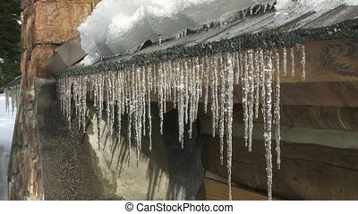 Mtn Cabin with Dripping Icicles - Row of melting icicles...