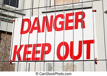 Danger keep out sign on a wire security fence