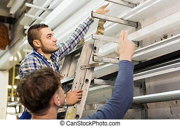 workmen choosing  PVC profile