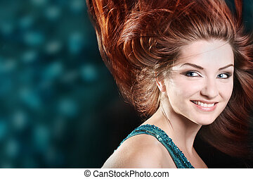 Beautiful woman smiling - A beautiful redhaired woman...
