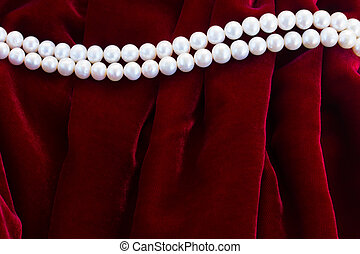 red velvet background with pearls - abstract texture of soft...