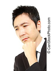 businessman thinks - portrait of Japanese businessman on...