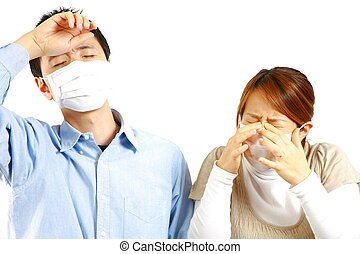 allergic rhinitis - portrait of Japanese couple on white...