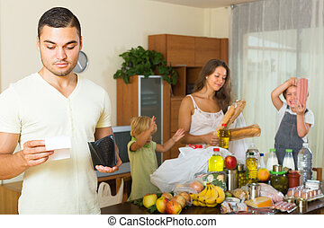 Poor family with bags of food - Sad man with receipt from...