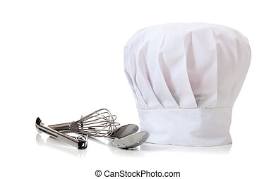 Chef Hat and utensils - A chefs hat and utensils on a white...