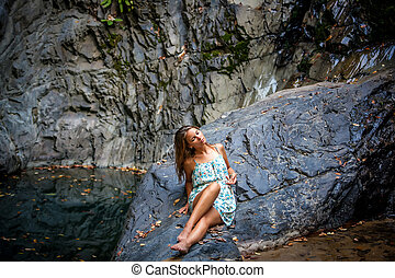 beautiful girl posing in dress at the waterfall - beautiful...