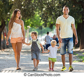 Russian family with children holding vacation day and...