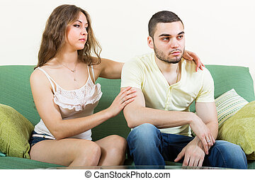 Woman concoling depressed man - Loving young woman tries...