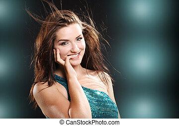 Beautiful woman smiling - A beautiful young brunette woman...