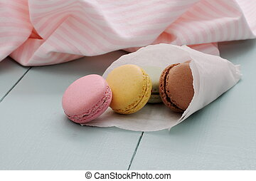 Macarons in backing paper cornet, close up