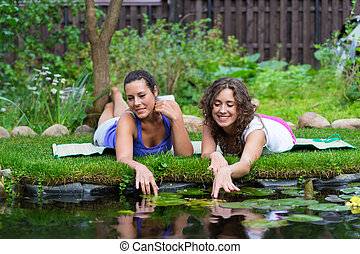 Two beautiful young brunet woman outdoors nature