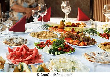 Celebrate banquet table with food - Festive banquet table...