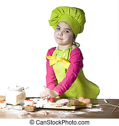 little cook - Little girl helps cook bake cookies for the...