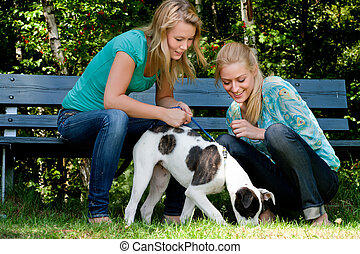 Two sisters and a dog