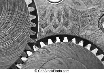 Black white background with metal cogwheels a old clockwork...