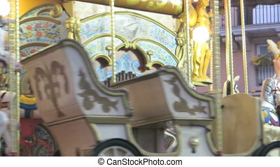 carousel detail - blurred spinning carousel detail