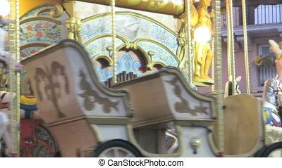 carousel detail - blurred spinning carousel detail