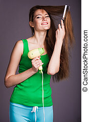 Woman with hair dryer
