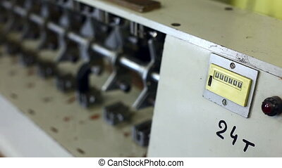 Counter on machine in production hall, close-up