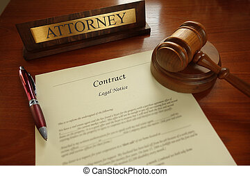 Legal contract with gavel and Attorney name plate on a desk...