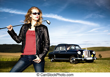 Golf Girl and a classic car - Girl with a golf driver and...
