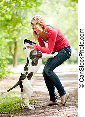 Cute girl and dog - Blond girl and a american bulldog in the...