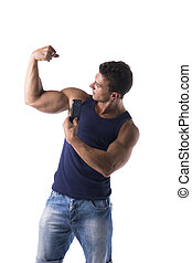 Strong muscular man flexing his arm muscles - Strong...