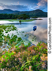 Lake in Killarney - Boats on water in Killarney National...