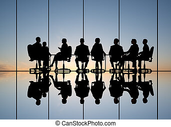 Business meeting - Silhouettes of group of business people...