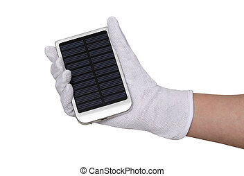 Solar panel charger - Human hand in glove hold solar panel...
