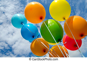 colorful balloons flying in the clouds