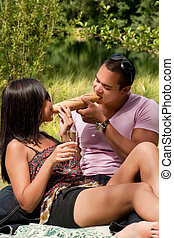 Share the baguette - Young happy asian couple enjoying their...