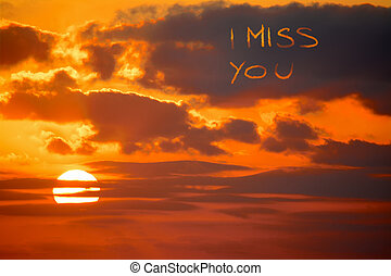 """i miss you written at sunset - """"i miss you"""" written at..."""