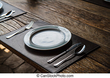 Plate fork spoon on the table